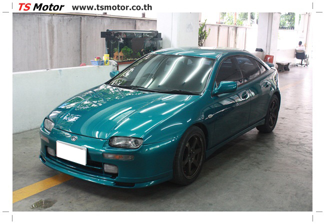 IMG 5044 งานซ่อมสีรอบคัน Mazda 323 สีฟ้า ซ่อมสีแตก สีไม่เงา เก็บงานตัวถังจากการชน